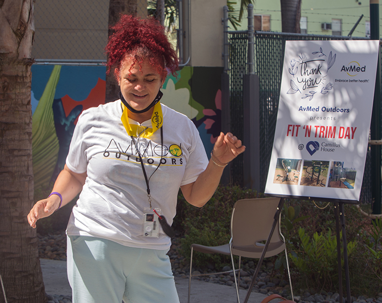 Coralia Serrano, a Camillus House client, dances to DJ Lu's music during Fit 'n Trim day, March 24, 2021.