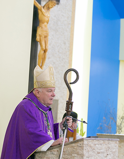 Archbishop Thomas Wenski preaches the homily congratulating Catholic Charities on its 90th anniversary,  March 26, 2021 at St. Joachim Church in Miami.