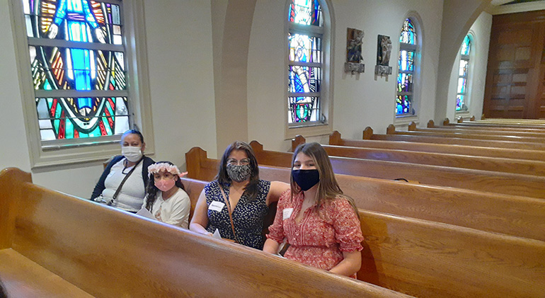 Nancy Mowa (far left) and her granddaughter Isabella Vasallo, who is participating in St. Joseph Parish's Rite of Christian Initiation of Adults (RCIA) program, wait for the Rite of Election ceremony to begin at St. Mary Cathedral, Feb. 21, 2021. They are seated with Agustina Morales, far right, who is also in the program, and her sponsor, Alicia Garcia.