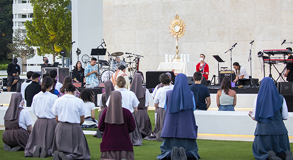 Over 200 attendees including members of the Servants of the Pierced Hearts of Jesus and Mary and members of the Daughters of St. Paul, participate in a moment of adoration during the EPIC Night of Mercy event celebrated at St. Thomas University in Miami Gardens, April 10, 2021.