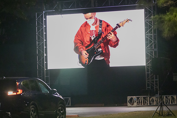 Organizers set up a drive-in style simulcast which allowed attendees to listen, watch, and tailgate from their vehicles during the EPIC Night of Mercy at St. Thomas University in Miami Gardens, April 10, 2021.