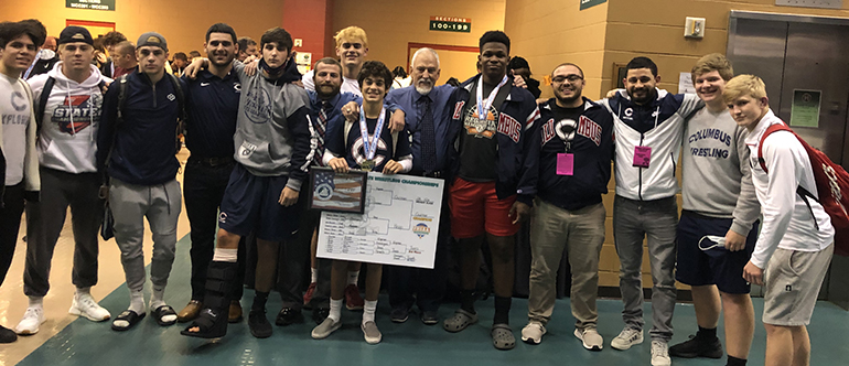 Columbus state wrestling champion Christian Guzman is pictured here with teammates and coaches after the state championship final in Kissimmee in March 2021.