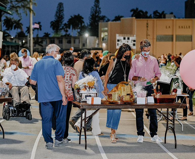 Immaculata-La Salle High School parents and benefactors take part in the Tricky Tray fundraising event March 18, 2021. Funds will go toward a new athletic field and fine arts building at the Miami high school.