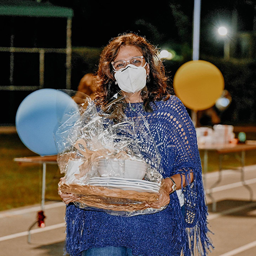 A woman walks away with her winnings at Immaculata-La Salle High School's Tricky Tray fundraising event March 18, 2021. Funds will go toward a new athletic field and fine arts building at the Miami high school.