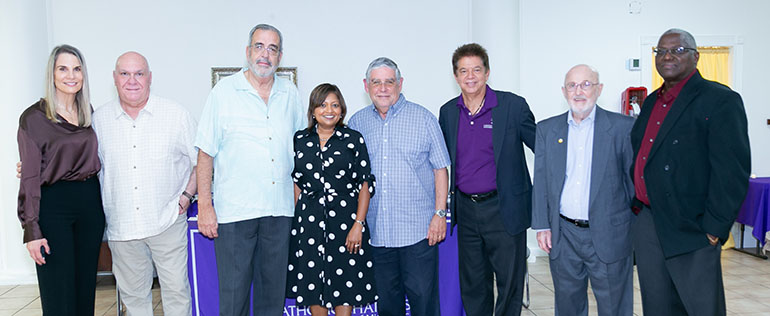 Catholic Charities employees pose with former Pedro Pans who are now members of the agency's board of directors after the 90th anniversary celebration, held March 26, 2021 at St. Joachim Church in Miami. From left: Gladys Palacios, John Louriel, Oreste Wrves, Mel Carmona, Devika Austin, Peter Routsis-Arroyo, Tom Comerford and Jules Jones.