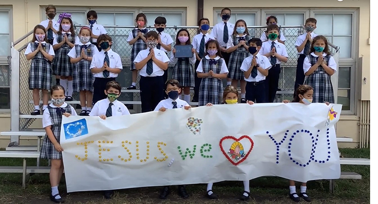 St. Theresa third graders, joined by the school's Honor Choir, conclude the annual Living Stations of the Cross safely and with love in 2021.
