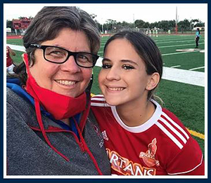 Valarie Lloyd, dean of students at Msgr. Edward Pace High School, takes a selfie with one of her students. She is also moderator of all athletics in the Archdiocese of Miami and has instituted Play Like a Champion training for coaches and athletes' parents throughout the archdiocese.