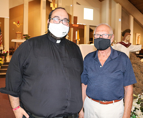 Father Matthew Gomez, vocations director for the Archdiocese of Miami, chats with Malcolm Meikle, president of the Serra Club of Broward County after a club gathering April 10, 2021 at St. Gabriel Church in Pompano Beach. The club collaborates with Father Gomez as part of their activities and mission.