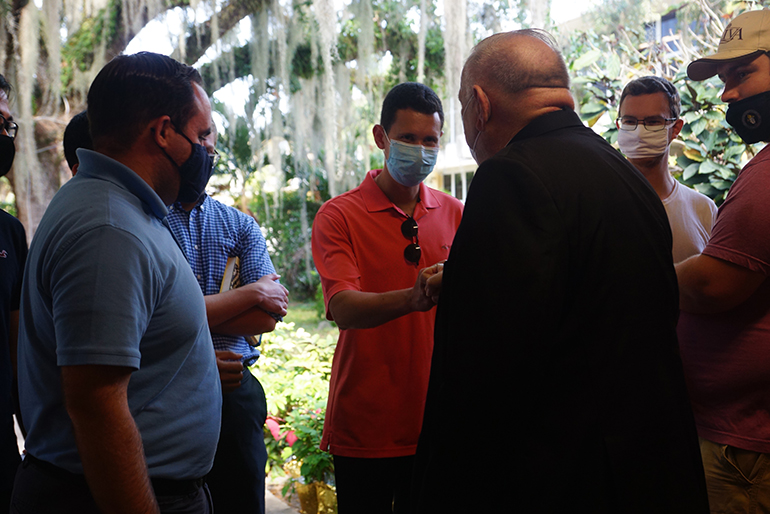Archbishop Thomas Wenski chats with seminarians from St. John Vianney College Seminary in Miami who got vaccinated against COVID-19 at Notre Dame d'Haiti Mission in Miami on April 14, 2021.