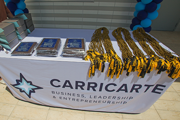 Senior business students at Christopher Columbus High School were honored with plaques and cords of distinction at an event April 15, 2021, marking the naming of the Carricarte Business, Leadership and Entrepreneurship career pathway at the all-boys Miami high school.