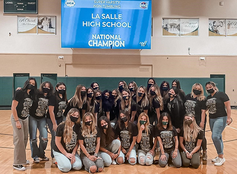 Immaculata-La Salle cheerleaders pose after getting the news they had won the national championship in Super Varsity Non-Tumbling, April 23, 2021. They also won back-to-back Florida state championships. Due to COVID-19, the national competition took place virtually this year.