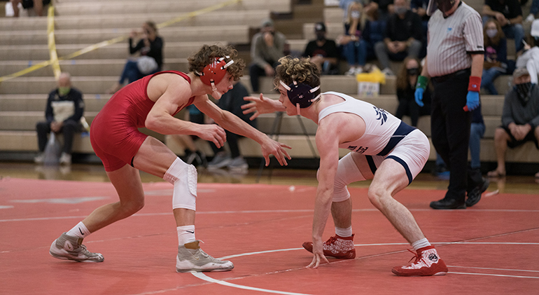 Cardinal Gibbons sophomore Nicholas Yancey, left, is seen here in action during his run to the state championship. Yancey guided the Chiefs to a fifth-place finish at the finals.