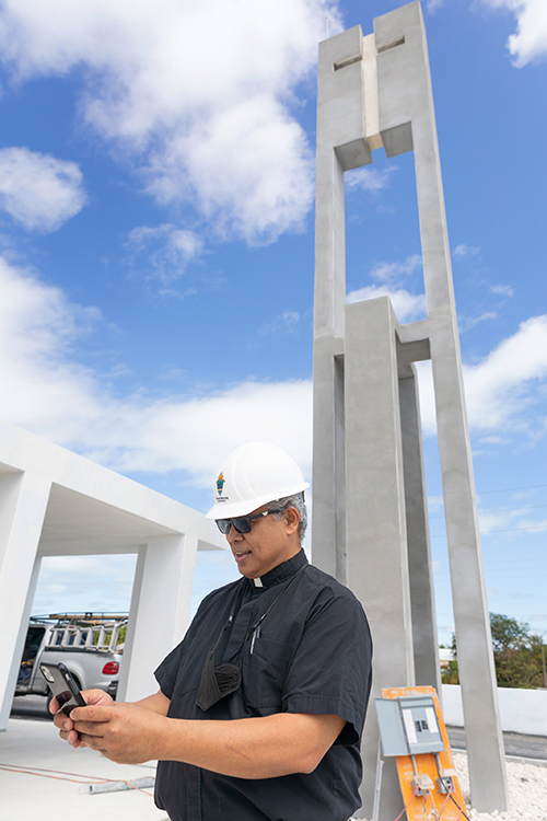 Father Jets Medina, parochial administrator of St. Peter Parish in Big Pine Key, stands in front of the bell tower that will make the rebuilt church more visible along U.S. 1.