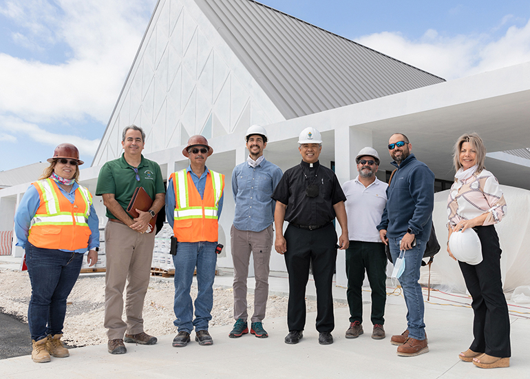 From left to right, standing in front of the new St. Peter Church in Big Pine Key, are Yolanda Arbesun, project manager, Florida LeMark Corp.; David Prada, Building and Properties director for the Archdiocese of Miami; Jesus Coriano, superintendent at Florida LeMark Corp.; Andres Arcila, landscape architect; Father Jets Medina, parochial administrator of St. Peter; Juan Calvo, architect from Oppenheim Architecture; Carlos Diez-Arguelles, project manager-owner representative, P&F Management Solutions, LLC; and Nancy McCrosson, property manager-bookkeeper at St. Peter.