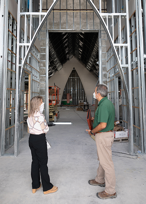Nancy McCrosson, property manager and bookkeeper at the St. Peter Parish, speaks with David Prada, senior director of Building and Property for the Archdiocese of Miami.