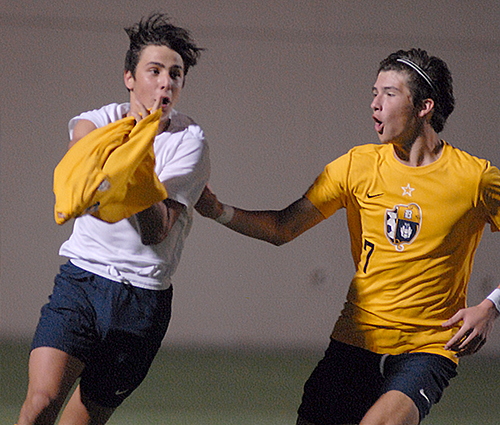 Stefano Naos, left, and Christian Bargueiras (7) celebrate Naos' goal during the second overtime of the Belen Jesuit Wolverines' 2-1 overtime victory over the Tampa Jesuit Tigers on Saturday, March 6, 2021, in the FHSAA Class 5A Boys Soccer Championship Game at Spec Martin Stadium in DeLand. The goal put Belen Jesuit ahead and helped the Wolverines win their second state title.