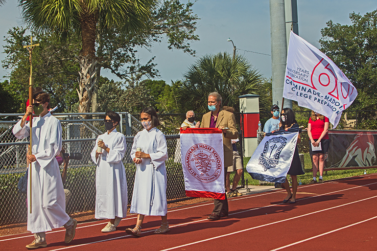 Students, board members and faculty process into Mass for the 60th anniversary of Chaminade-Madonna College Preparatory in Hollywood, April 25, 2021. The Mass was held on the school's Vince Zappone Field.