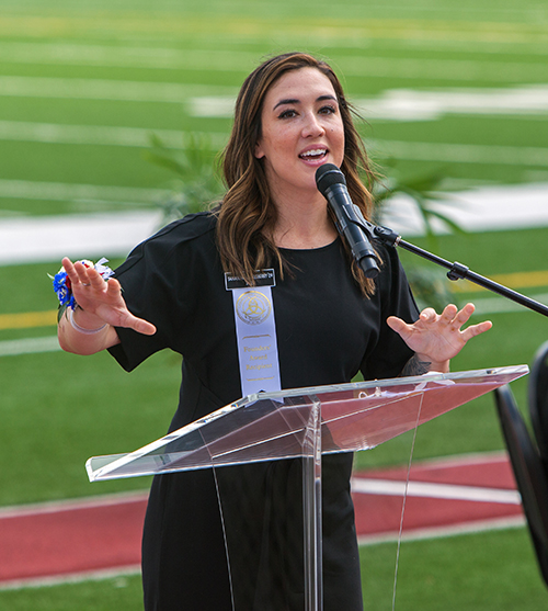 Founders' Award recipient Samantha Stokesberry addresses those in attendance at Chaminade-Madonna College Preparatory's 60th anniversary Mass, celebrated April 25, 2021 at the school's Vince Zappone Field.