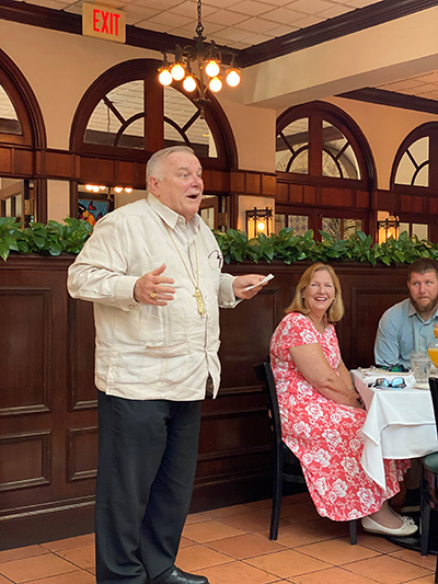 Archbishop Thomas Wenski welcomes participants to the Cheers for Charity event held at Joe's Stone Crabs on Miami Beach, April 28, 2021.