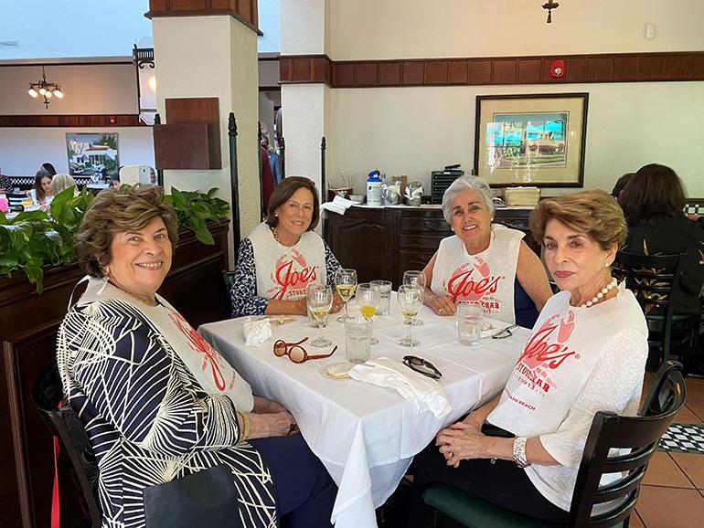 Enjoying the Cheers for Charity event held at Joe's Stone Crabs on Miami Beach, April 28, 2021, are Gloria Arazoza (third from left) and her friends, Olga Campano, Elena Ramos and Georgina Garcia.
