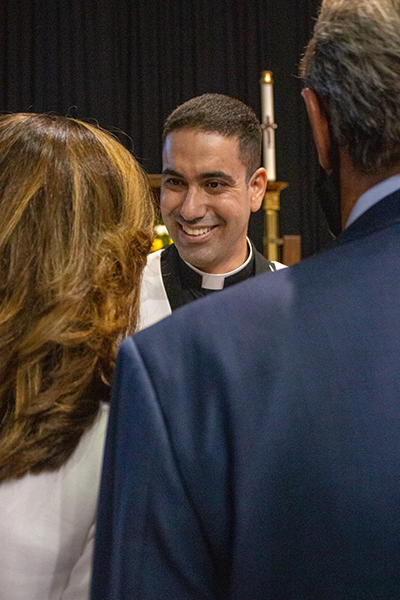 Newly ordained Father Leandro Siqueira is greeted by well wishers after the ceremony.
