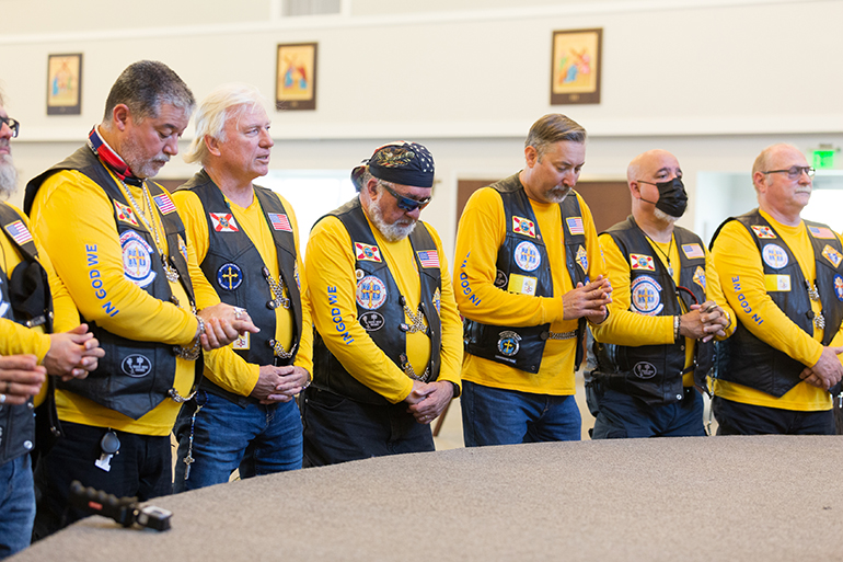 Knights on Bikes pray before the start of the first Knights of Columbus-affiliated Ride for Vocations conducted in Florida and held May 27, 2021 starting at St. Katharine Drexel in Weston.