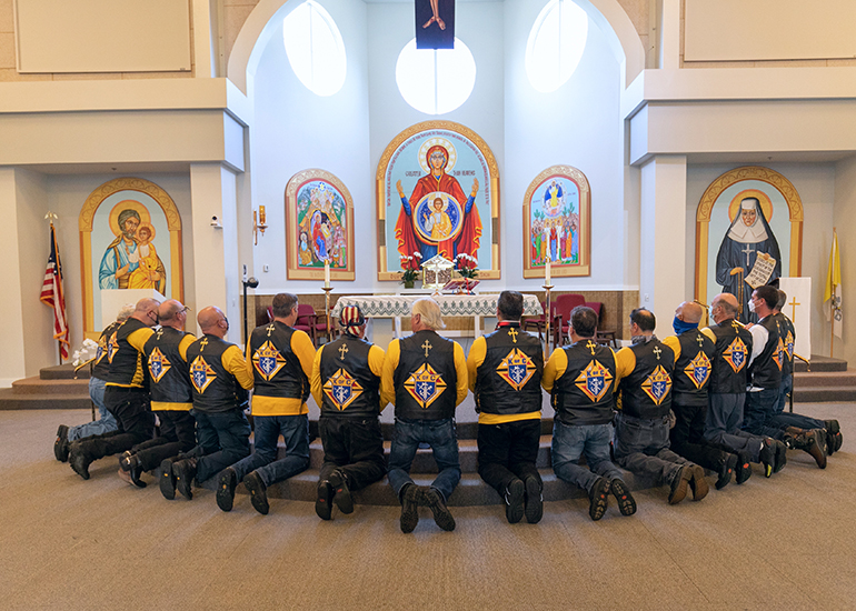 Knights on Bikes pray before the start of the first Knights of Columbus-affiliated Ride for Vocations conducted in Florida and held May 27, 2021 starting at St. Katharine Drexel in Weston. Miami Archbishop Thomas Wenski celebrated a morning Mass and led the ride all the way to the Knights of Columbus Kissimmee Council Hall No. 6624 south of Orlando. All donations benefited Florida seminarians.