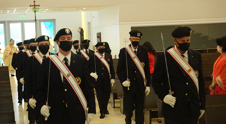 Knights of Columbus provide an honor guard at the start of the Memorial Day Mass celebrated by Archbishop Thomas Wenski at Our Lady of Guadalupe Church in Doral, May 31, 2021.
