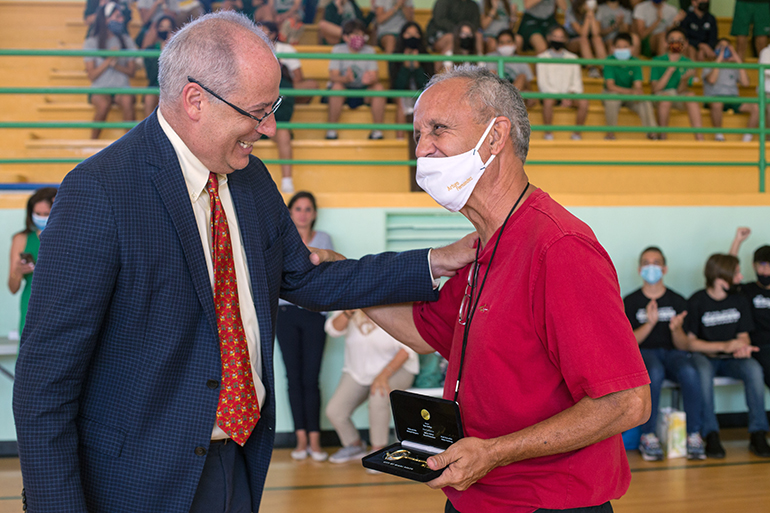 Miami Beach Mayor Dan Gelber presents the Key to the City to Art Fernandez, who is retiring after 39 years as St. Patrick School's physical education teacher.