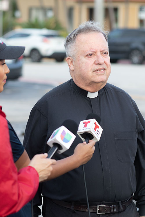 Father Juan Sosa, pastor of St. Joseph Church, Miami Beach, the church nearest to the partially-collapsed condo building in Surfside, speaks with the media June 25, 2021.