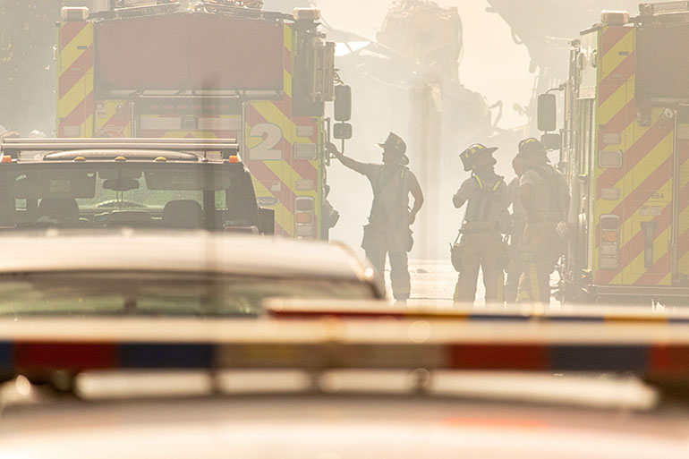 Fire rescue and search specialists at work June 25, 2021 near the partially collapsed Champlain Towers South in Surfside the day after the tragic event.