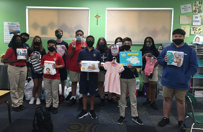 """June 2021 Deerfield Beach  Seventh grade students at St. Ambrose School collected donations for a """"Right to Life Baby Shower"""" they hosted to benefit mothers and their newborns and toddlers at the Right to Life Pregnancy Center in Coconut Creek."""