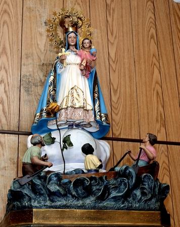 A statuette of Our Lady of Charity embodies the church's closeness with the surrounding Cuban-American community.