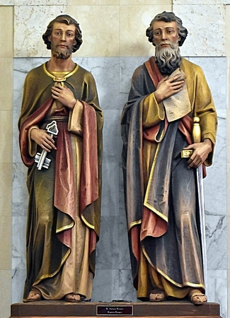 The dual patron saints of the church look out over the nave. St. Peter, left, is shown with the keys to the kingdom of heaven, given him by Jesus. Paul holds one of the 13 New Testament manuscripts ascribed to him -- and the sword with which he was martyred.