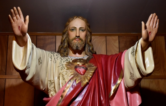 Jesus shows his wounded hands and his Sacred Heart in a full-size statue.
