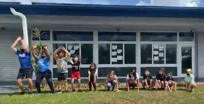 """June 2021 Deerfield Beach  Here comes the wave: Coach Sean McKeown from St. Ambrose School and students """"wave"""" good-bye to the 2021 academic year."""
