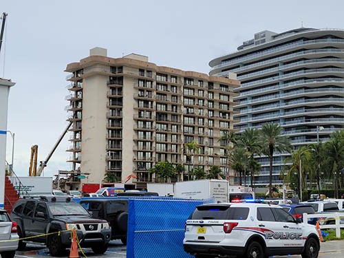 A view two streets west of the Champlain Towers South condominium in Surfside reveals part of the building that is still standing as recovery efforts continued June 30, 2021. Collins avenue, and its surrounding perimeter, have served as a major disaster recovery site with local, state, national, and international assistance on site.