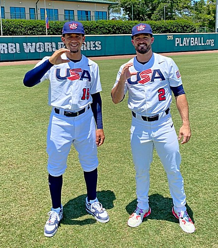 Jon Jay, left, and Eddy Alvarez make the capital 'C' gesture for their alma mater, Christopher Columbus High School. Both will join the U.S.A. baseball beam for the Summer Olympics in Tokyo.