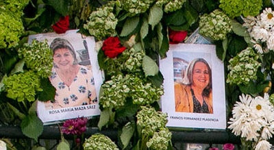 Photos of Rosi Maza, left, and Francis Plasencia as seen on the wall of remembrance for those killed in the collapse of the Champlain Towers South condominium. The wall is on the fence of a tennis court just west of the collapsed building.