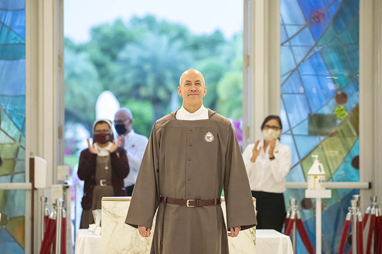 Father Joseph Mary of the Priestly, Pierced and Eucharistic Heart of Jesus, clad in his new religious habit, walks towards the sanctuary of Our Lady of Guadalupe Church in Doral.