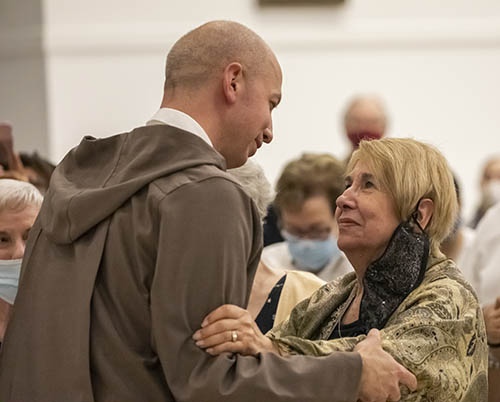 Father Joseph Mary, newly professed Servant of the Pierced Hearts of Jesus and Mary,  hugs his mother Judy Rogers, during the Mass for his profession of first religious vows. He made his vows on June 29, 2021 at Our Lady of Guadalupe Church in Doral.