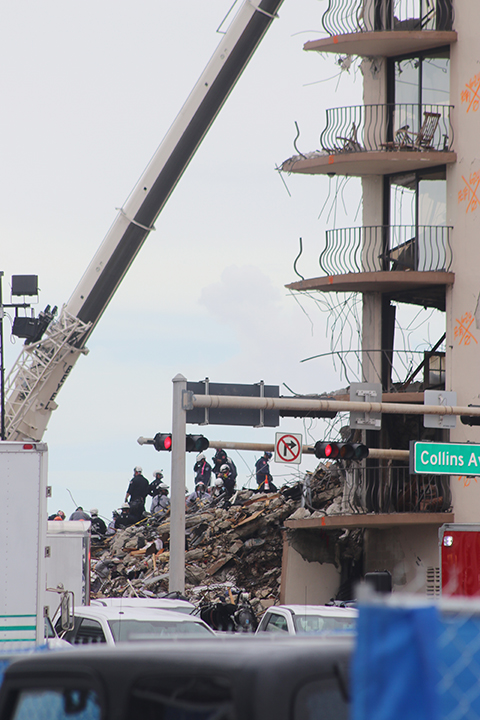 Search and rescue teams look for survivors among the rubble of the partially collapsed Champlain Towers South condominium in Surfside, June 30, 2021. A few days later, on July 4, the part of the building that remained standing was demolished by the authorities to speed up the search and rescue process.