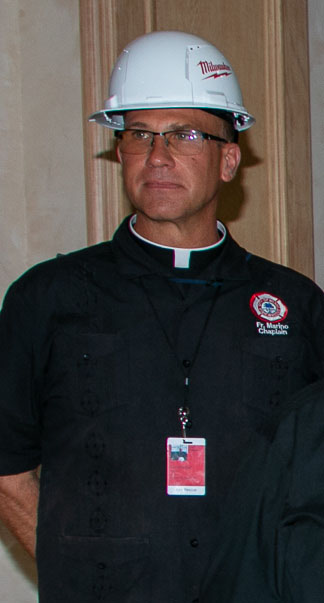 Father Christopher Marino is pictured during a visit to the site of the partially collapsed Champlain Towers South on July 2, 2021.