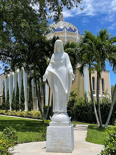 View of the Marian statue commissioned by Hilda Noriega in honor of her deceased daughter and initially located outside the chapel of Archbishop Curley-Notre Dame High School. It is now located on the southeast corner of St. Mary Cathedral, across the street from the parish hall.