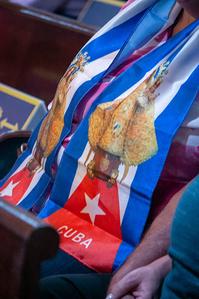 A woman wears a scarf with the image of Our Lady of Charity and the colors of the Cuban flag during a Mass for Cuba celebrated by Archbishop Thomas Wenski at the Shrine of Our Lady of Charity on July 13, 2021, two days after anti-government protests broke out all over the island.