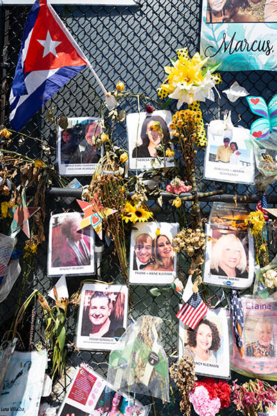 """One month after the tragic Surfside condo collapse, an ever-evolving """"wall of remembrance"""" nearby commemorates the lives of the 97 victims identified so far in the June 24, 2021 tragedy."""