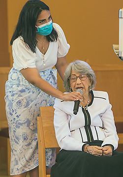 Natalie Marmalejos holds the microphone for her grandmother, Sofia Ruiz, 92, as she recites the rosary prior to the Mass for the World Day for Grandparents and the Elderly at St. Thomas University, July 25, 2021. Miami Auxiliary Bishop Enrique Delgado celebrated the special Mass at the university's St. Anthony Chapel.