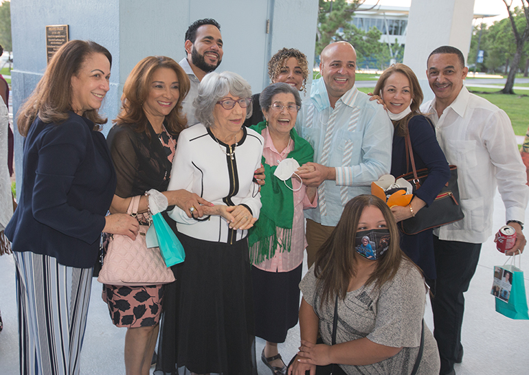 Sofia Ruiz and Reina Marmolejos, center, pose for a photo with a few members of their family after the Mass marking the first World Day for Grandparents and the Elderly, July 25, 2021. Miami Auxiliary Bishop Enrique Delgado celebrated the Mass at St. Thomas University's St. Anthony Chapel.