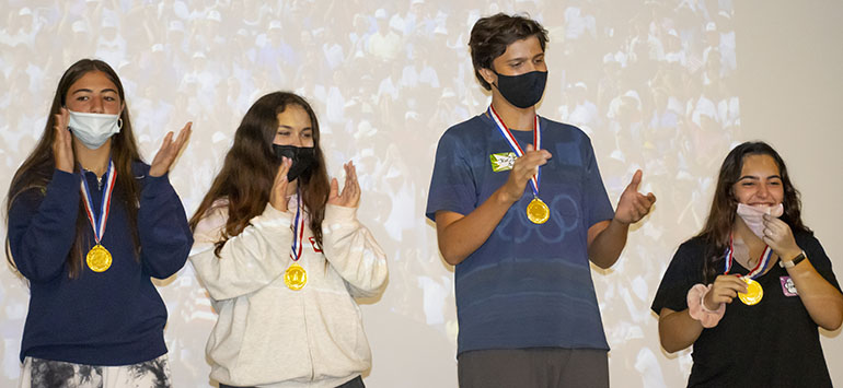 Members of the first place team take part in the award ceremony at the conclusion of the Blessed Trinity Life Teen Office Olympics, Sept. 12, 2021. From left: Natalia Perez from Our Lady of Lourdes Academy, Isabella Travieso from St. Brendan High School, Jacob Caudle from Belen Jesuit Preparatory School, and Gena Escanaverino from St. Brendan High School.