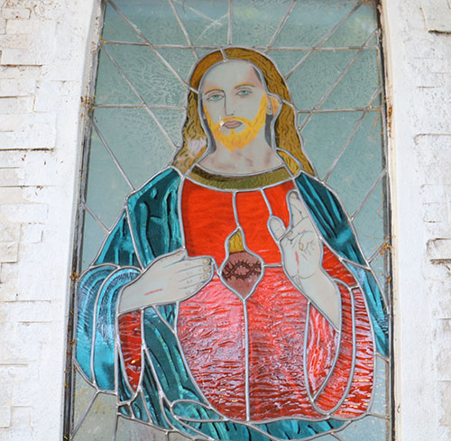 An image of the Sacred Heart of Jesus is displayed on the grounds of San Isidro Parish in Pompano Beach, one of  many displayed on the parish grounds and in the church, where 72 parishioners became new members of the Guard of the Sacred Heart on its feast day, June 11, 2021.